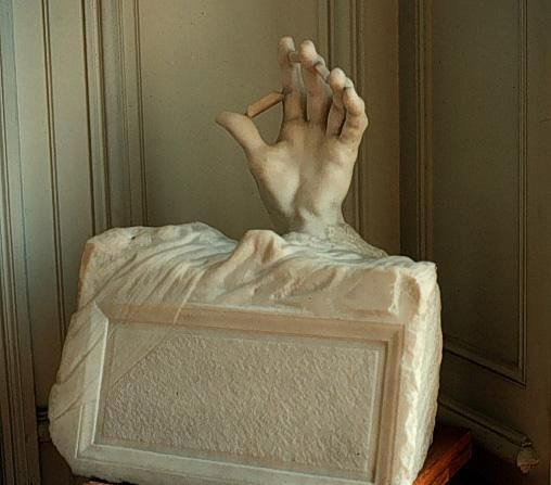Hand coming out of a tomb